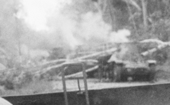 Close up of Ha-Go tanks in the background of the famous shot