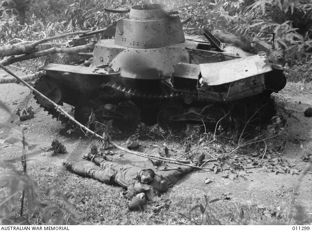 4102597one-of-six-ha-go-tanks-destroyed-by-an-australian-oqf-2-pounder-anti-tank-gun-in-the-battle-of-muar-the-escaping-tank-crew-were-killed-by-allied-infantry