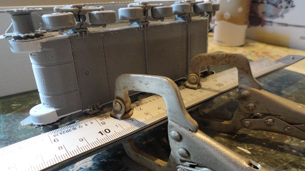 two steel rulers and welding clamps b